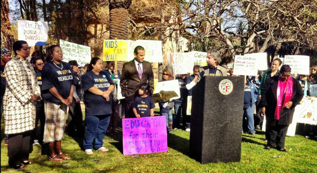 Parents and Los Angeles city leaders speak at a rally supporting a new hybrid charter and public school.
