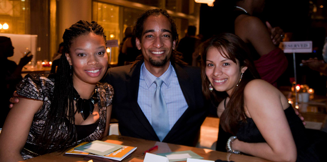 Guests pose for a photo seated at a table at the Wit Hotel during the 2014 Alumni Honors Gala