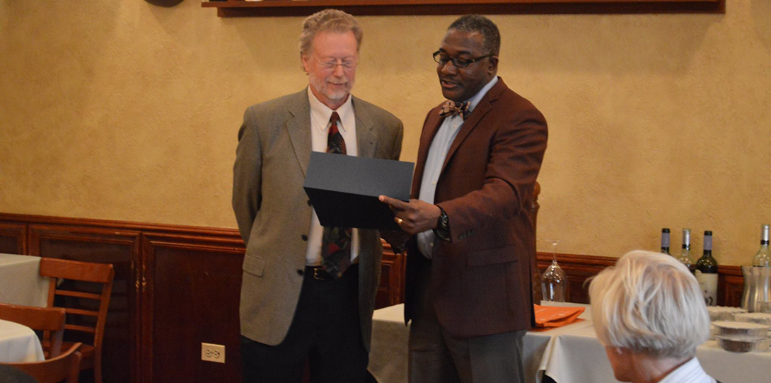 Dean Alfred Tatum presents Mark Smylie with the inaugural Proud of our History Award