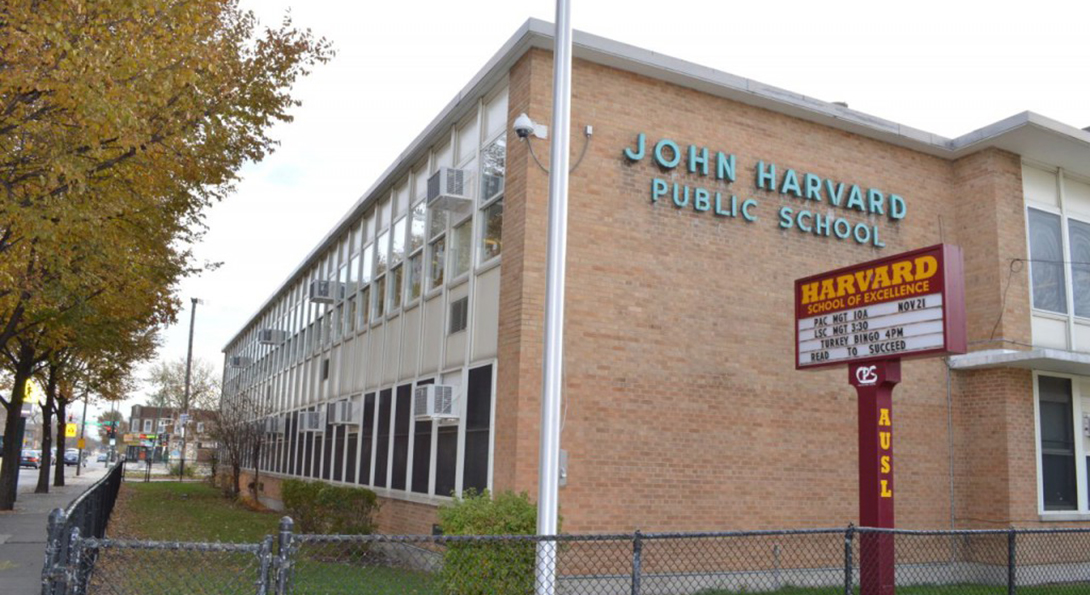 The building of John Harvard Elementary School viewed from the street.