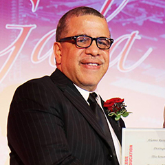 Ernesto Matias accepts his award from Dean Alfred Tatum and poses for a picture while doing so at the 2017 Alumni Honors Gala.
