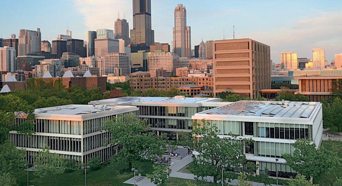 An aerial view of the UIC campus and Douglas Hall, with the Chicago skyline in the background.