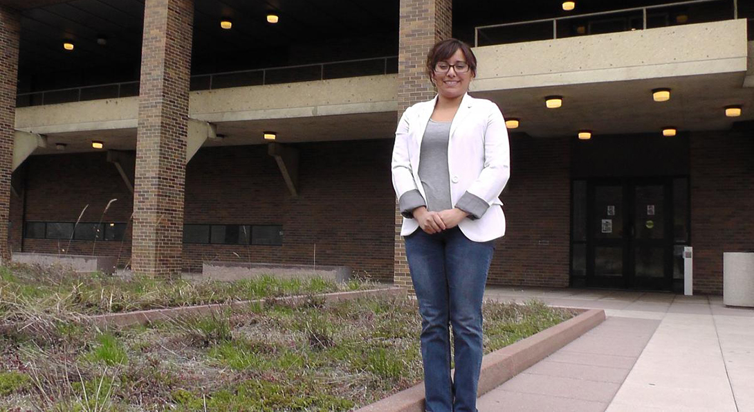 Zayoni Torres stands outside the College of Education building, posing for a photo.