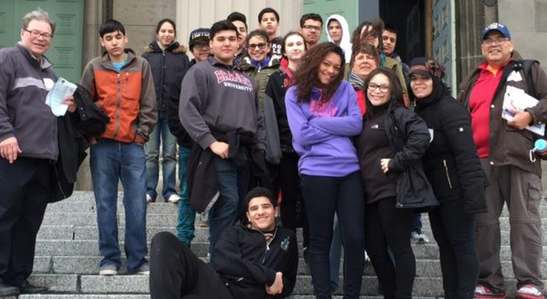 Mentors with the St. Aloysius Youth Group pose for a photo standing on the stairs in front of St. Aloysius Church.