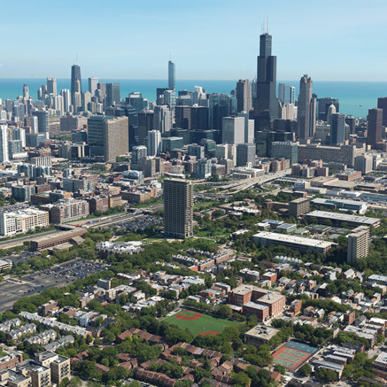 An aerial view of the Chicago skyline, with Lake Michigan in the background and the UIC campus in the foreground.
