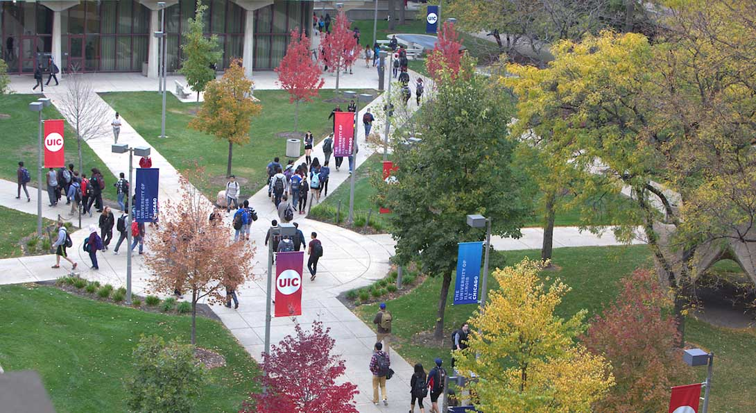 Aerial view of students walking through campus.