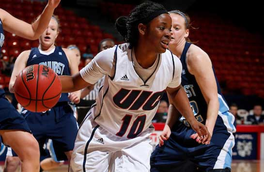 UIC women's basketball player Terri Bender dribbles around an Elmhurst College defender in a game at the UIC Pavilion.