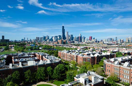 An aerial view of the University Village apartments, with the Chicago skyline in the background.