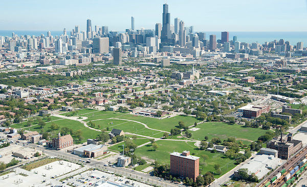 An aerial view of the Chicago skyline, shown from the southwest side of the city and portraying southwest side neighborhoods.