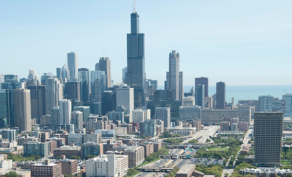 A view of the Chicago skyline shown from Interstate 290 near the UIC campus.  University Hall is in the foreground to the right.