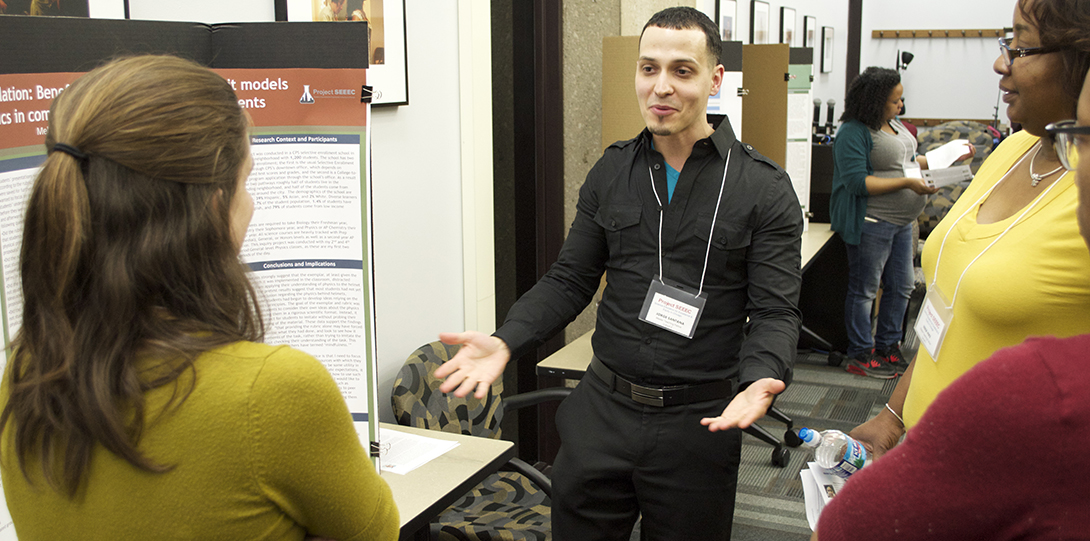 Master Teaching Fellow Jorge Santana engages SEEEC teaching fellows in conversation on his poster presentation.