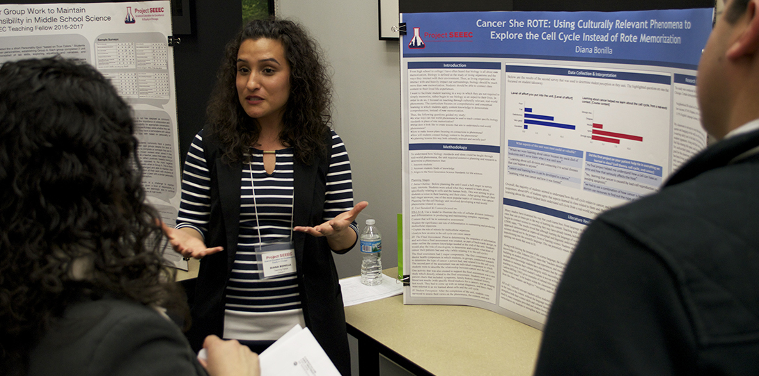SEEEC Teaching Fellow Diana Bonilla explains her poster presentation to two other fellows.