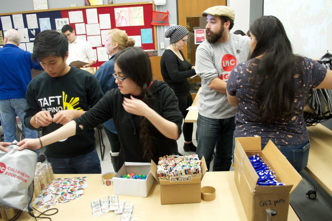 Students and volunteers package educational materials
