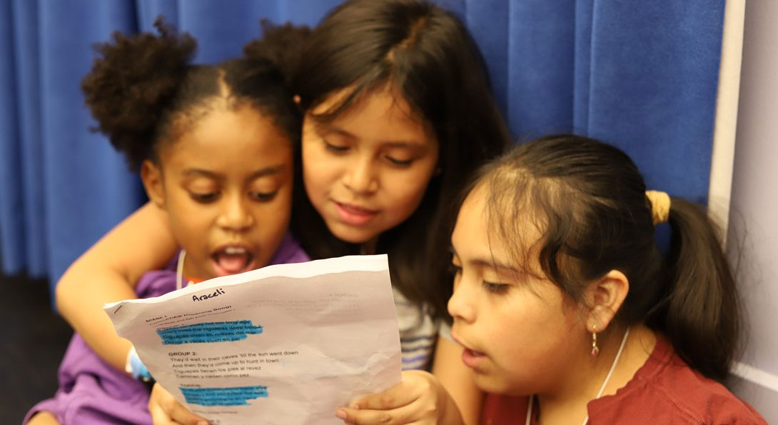 Third grade students read a script together