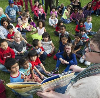 Early Childhood Educator reads to children